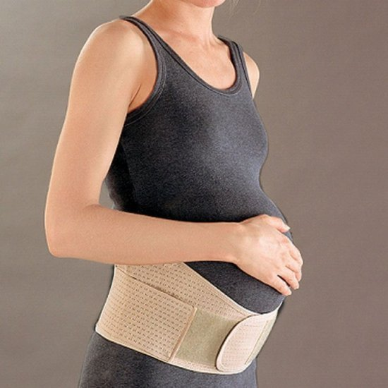 Болит спина при беременности: причины и лечение